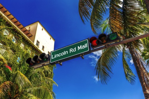https://suiteness.imgix.net/destinations/miami/bigstock-Street-Sign-Lincoln-Road-Mall--50342768.jpg?mono=33EBC862&blend=2A303F&shad=90&gam=20&auto=format,compress