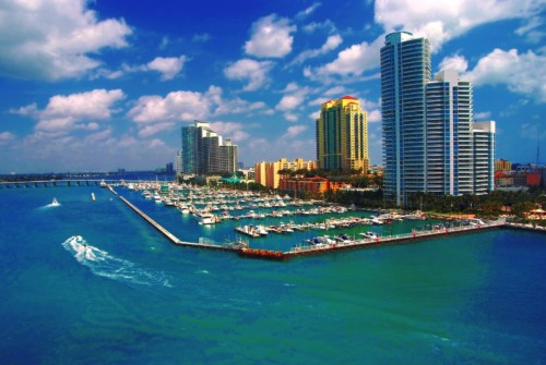 https://suiteness.imgix.net/destinations/miami/bigstock-aerial-view-of-south-miami-bea-89783798.jpg?mono=33EBC862&blend=2A303F&shad=90&gam=20&auto=format,compress