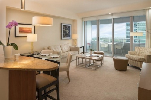 https://suiteness.imgix.net/destinations/miami/conrad-miami/suites/bay-view-2-bedroom-condo-with-2-king-beds/living-area.jpg?w=96px&h=64px&crop=edges&auto=compress,format