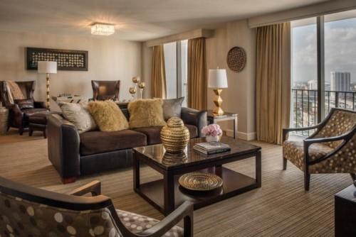 https://suiteness.imgix.net/destinations/miami/hyatt-regency-miami/suites/vip-suite-standard-king-room-standard-king-room/living-room.jpg?w=96px&h=64px&crop=edges&auto=compress,format