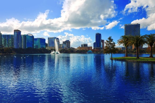 https://suiteness.imgix.net/destinations/orlando/bigstock-orlando-skyline-from-lake-eola-136803416.jpg?mono=33EBC862&blend=2A303F&shad=90&gam=20&auto=format,compress