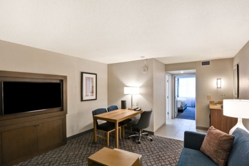 https://suiteness.imgix.net/destinations/orlando/embassy-suites-orlando-downtown/suites/2-room-suite-2-double-beds-non-smoking-2-room-suite-2-double-beds-non-smoking/living-area-2.jpg?w=96px&h=64px&crop=edges&auto=compress,format