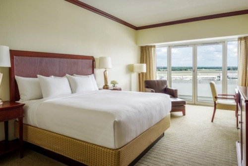 https://suiteness.imgix.net/destinations/orlando/hyatt-regency-orlando-international-airport/suites/vip-suite-king-room/bedroom.jpg?w=96px&h=64px&crop=edges&auto=compress,format