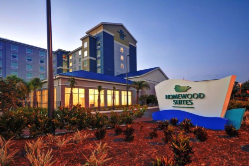 https://suiteness.imgix.net/destinations/orlando/homewood-suites-by-hilton-orlando-theme-parks/entrance.jpg?mono=33EBC862&blend=2A303F&shad=90&gam=20&auto=format,compress
