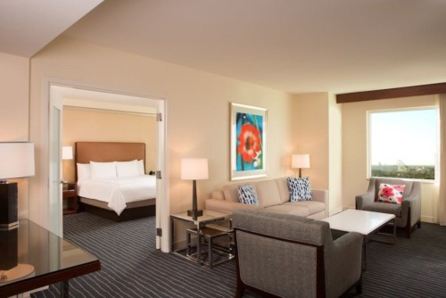 https://suiteness.imgix.net/destinations/orlando/hilton-orlando/suites/1-bedroom-suite-1-king-bed/living-room.jpg?w=96px&h=64px&crop=edges&auto=compress,format